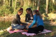 three young hotties spending time in the forest