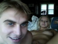 young couple record home videos on the web camera